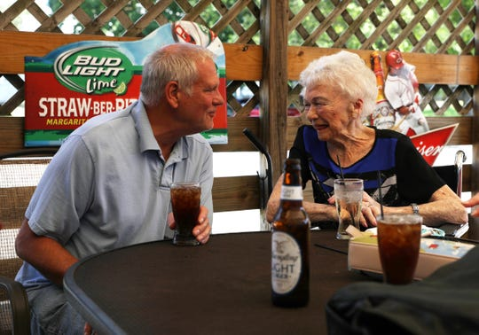 Owner John Gildow talks with long-time customer Margaret McConnell on the patio at South 60 Drive-Thru and Tavern in Zanesville recently.