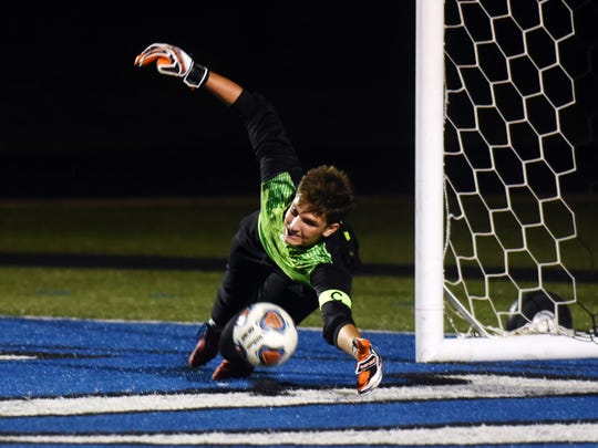 Cobe Curry makes a diving save during Zanesville's 3-1 win against Marietta this past season at John D. Sulsberger Memorial Stadium. Curry signed with Malone University on Friday.