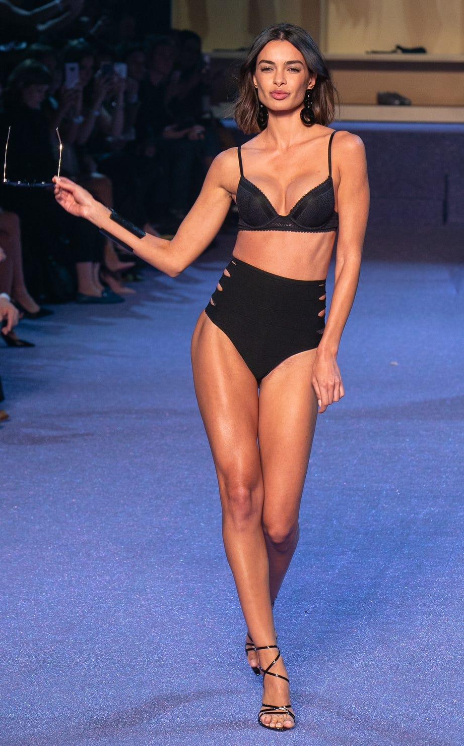 A model presents a ETAM creation at the Paris Fashion Week Womenswear Spring/Summer 2019.