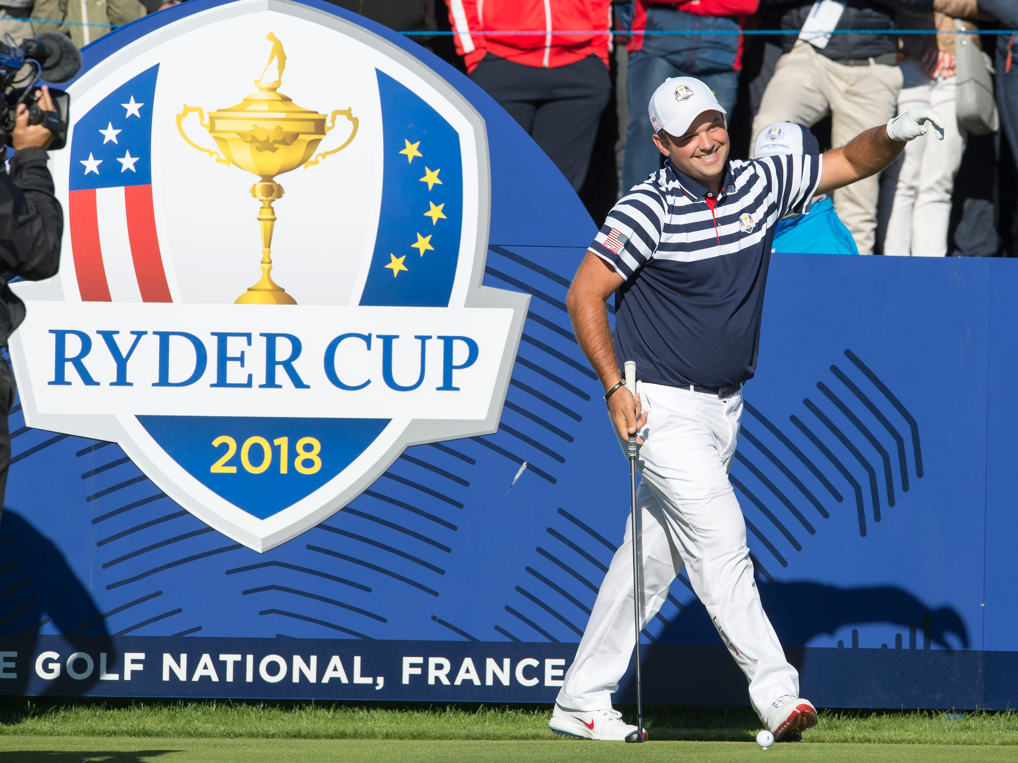 Patrick Reed prepares to tee off during a Ryder Cup practice round.