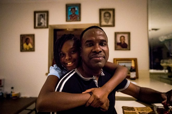 In this 2018 photo, Rony Ponthieux and his then 11-year-old daughter Ronyde Christina Ponthieux weren't sure if they would be able to stay in the U.S. as the Trump administration began phasing out the Temporary Protected Status (TPS) program. Two years later, they are still facing uncertainty as court cases and ensuing legal challenges continue.