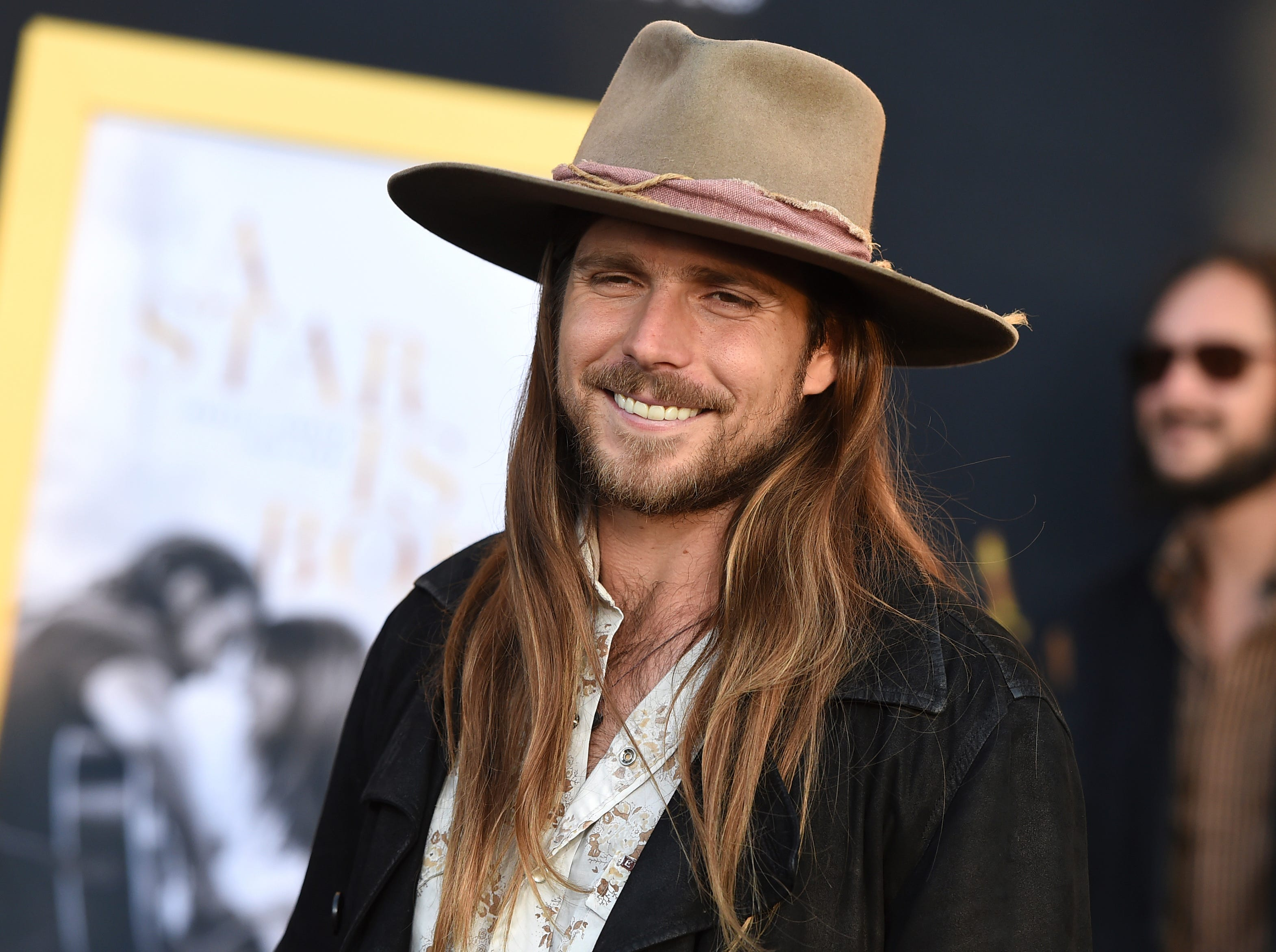 "Lukas Nelson arrives at the Los Angeles premiere of ""A Star Is Born"" on Monday, Sept. 24, 2018, at the Shrine Auditorium. (Photo by Jordan Strauss/Invision/AP) ORG XMIT: CAPM119"