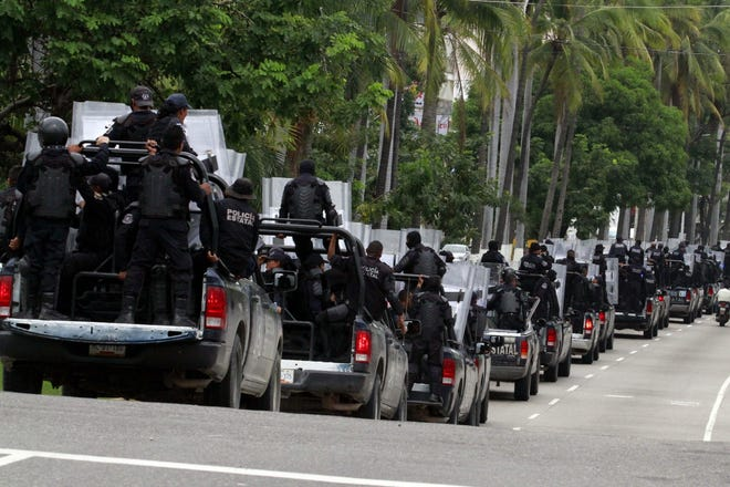 Authorities in southern Mexico disarmed the entire police force in Acapulco and placed it under investigation, in a claim that the 'local cops were infiltrated by drug gangs and the complete inaction of the municipal police in fighting the crime wave'.