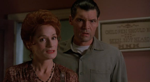 """Wendy Robie and Everett McGill are a couple with some dark business in their basement in """"The People Under the Stairs."""""""