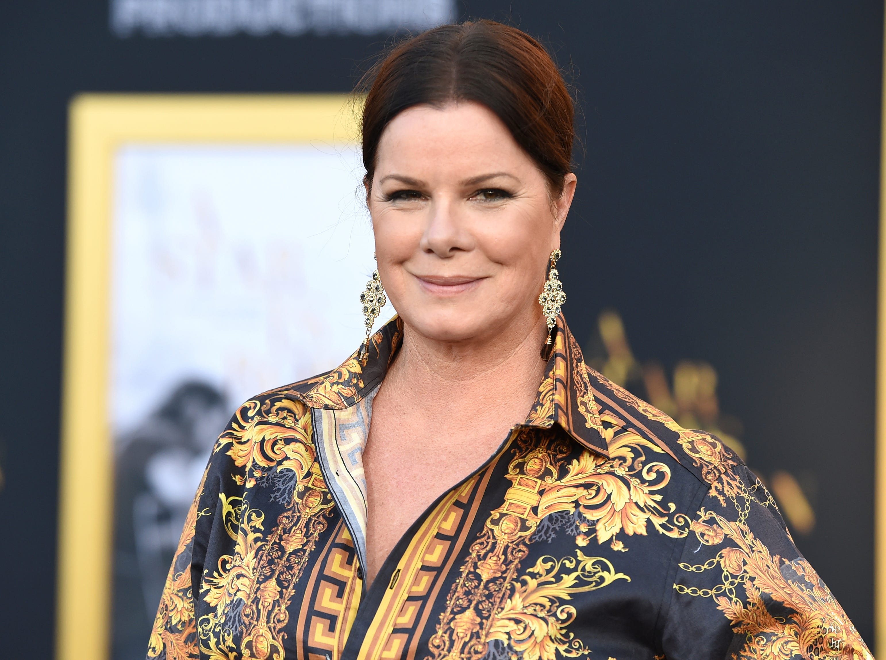 "Marcia Gay Harden arrives at the Los Angeles premiere of ""A Star Is Born"" on Monday, Sept. 24, 2018, at the Shrine Auditorium. (Photo by Jordan Strauss/Invision/AP) ORG XMIT: CAPM120"
