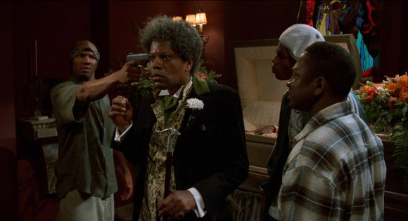 "Clarence Williams III (center) is the eccentric mortician of ""Tales from the Hood."""