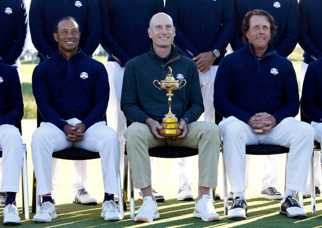 (From left to right) Tiger Woods, USA team captain Jim Furyk and Phil Mickelson pose for a photo during a Ryder Cup practice round at Le Golf National.