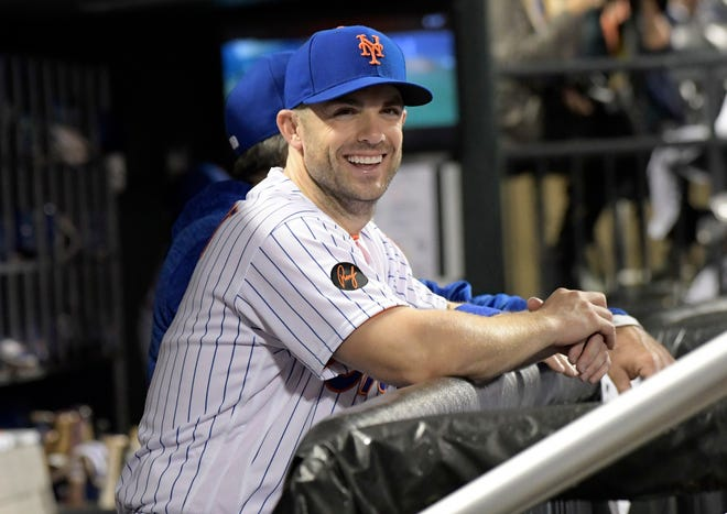 David Wright watches from the New York Mets' dugout during the seventh inning against the Atlanta Braves.
