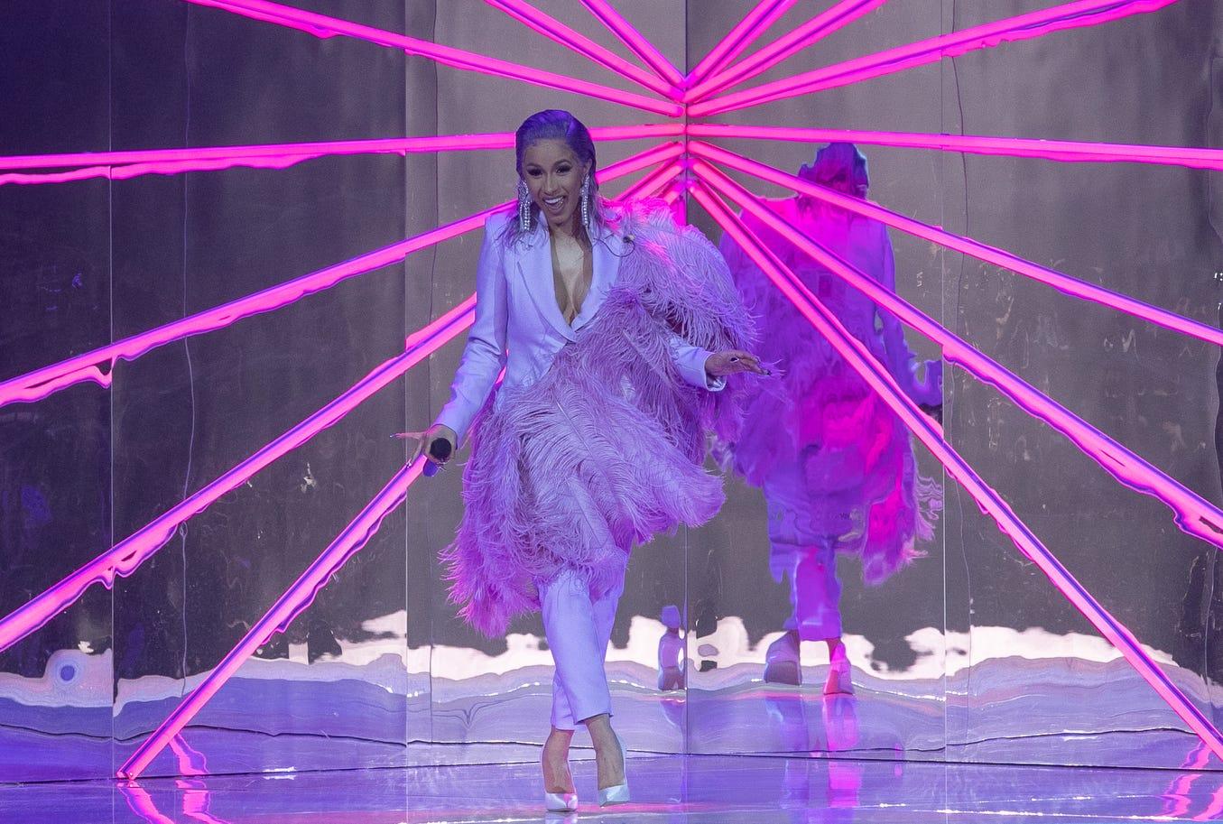 Cardi B. performs during the ETAM show as part of the Paris Fashion Week Womenswear Spring/Summer 2019.