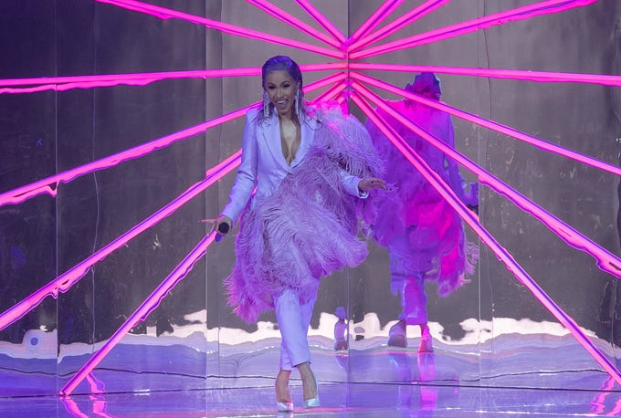 Cardi B. performs during the ETAM show as part of the Paris Fashion Week Womenswear Spring/Summer 2019.