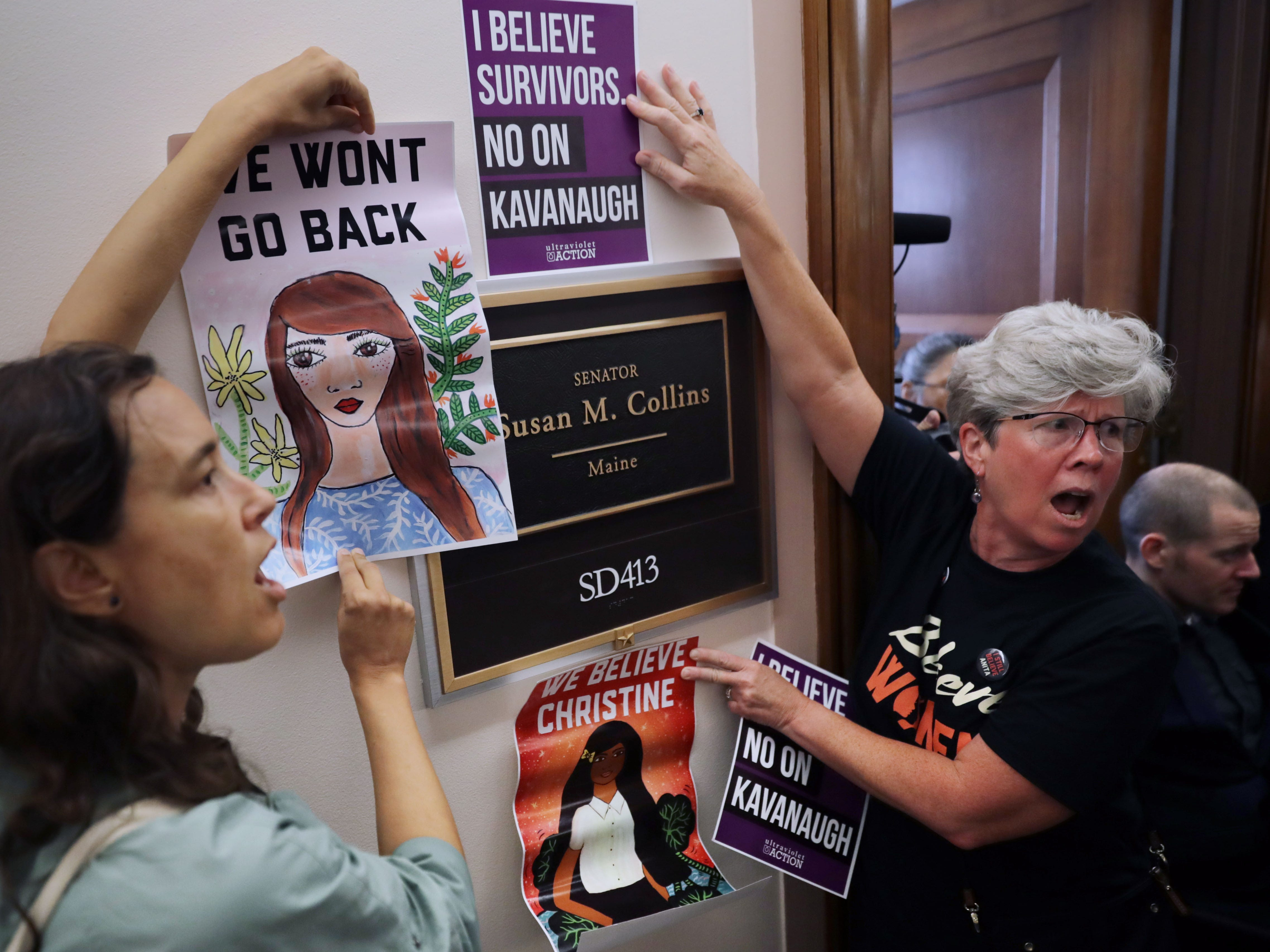 WASHINGTON, DC - SEPTEMBER 26:  Dozens of protesters, including many sexual assault survivors, demonstrate against the appointment of Supreme Court nominee Judge Brett Kavanaugh outside the offices of Sen. Susan Collins (R-ME) in the Dirksen Senate Office Building on Capitol Hill September 26, 2018 in Washington, DC. More than a dozen protesters were arrested after visiting the offices of three women senators to demonstrate against the appointment of Kavanuagh, who has been accused by at least two women of sexual assault. (Photo by Chip Somodevilla/Getty Images) ORG XMIT: 775233312 ORIG FILE ID: 1044935888