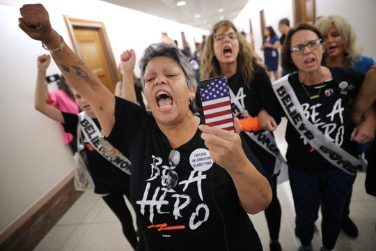 WASHINGTON, DC - SEPTEMBER 26:  Dozens of protesters, including sexual assault survivor Mary Jane Maestras (L) of Delta, Colorado, demonstrate against the appointment of Supreme Court nominee Judge Brett Kavanaugh outside the offices of Sen. Susan Collins (R-ME) in the Dirksen Senate Office Building on Capitol Hill September 26, 2018 in Washington, DC. More than a dozen protesters were arrested after visiting the offices of three women senators to demonstrate against the appointment of Kavanuagh, who has been accused by at least two women of sexual assault. (Photo by Chip Somodevilla/Getty Images) ORG XMIT: 775233312 ORIG FILE ID: 1044936456