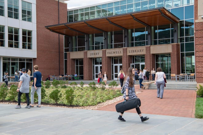 Liberty University students pass by the Jerry Falwell Library on Wednesday. The school is sending students to Washington on Thursday to support Supreme Court nominee Brett Kavanaugh.