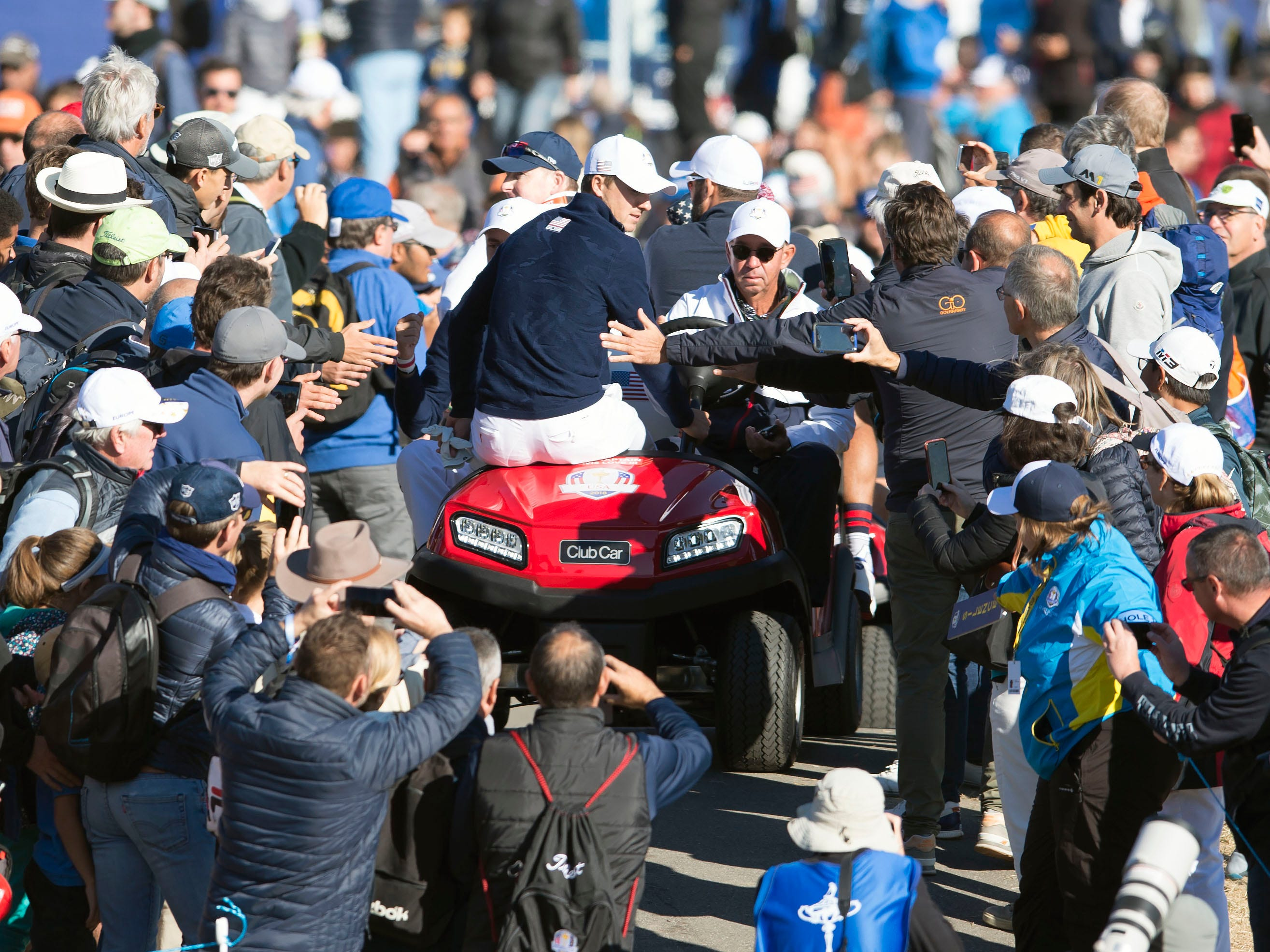 Jordan Spieth and Justin Thomas make their way by buggy during a Ryder Cup practice round.