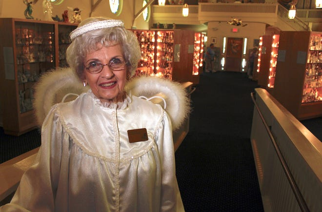 In this Sept. 13, 2018, photo, Joyce Berg stands in The Angel Museum in Beloit, Wis.