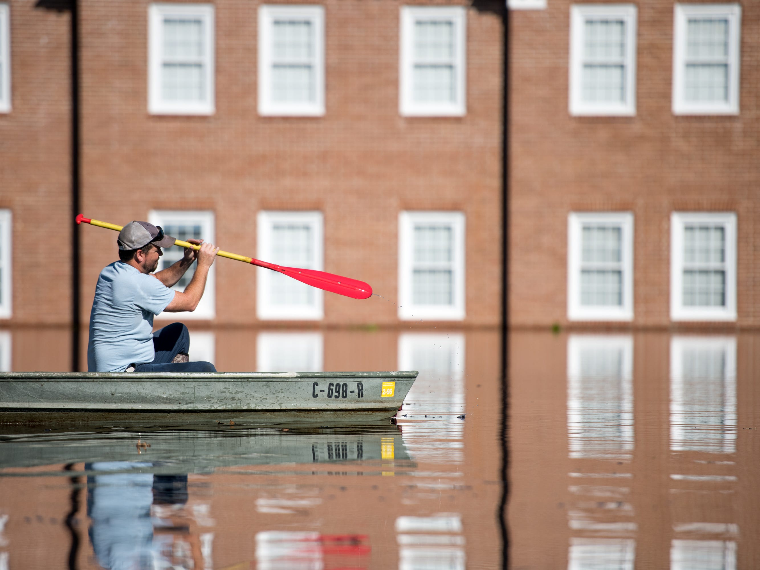 Taylor James paddles a boat in floodwaters caused by Hurricane Florence in front of Trinity United Methodist Church near the Crabtree Swamp on Sept. 26, 2018 in Conway, S.C.