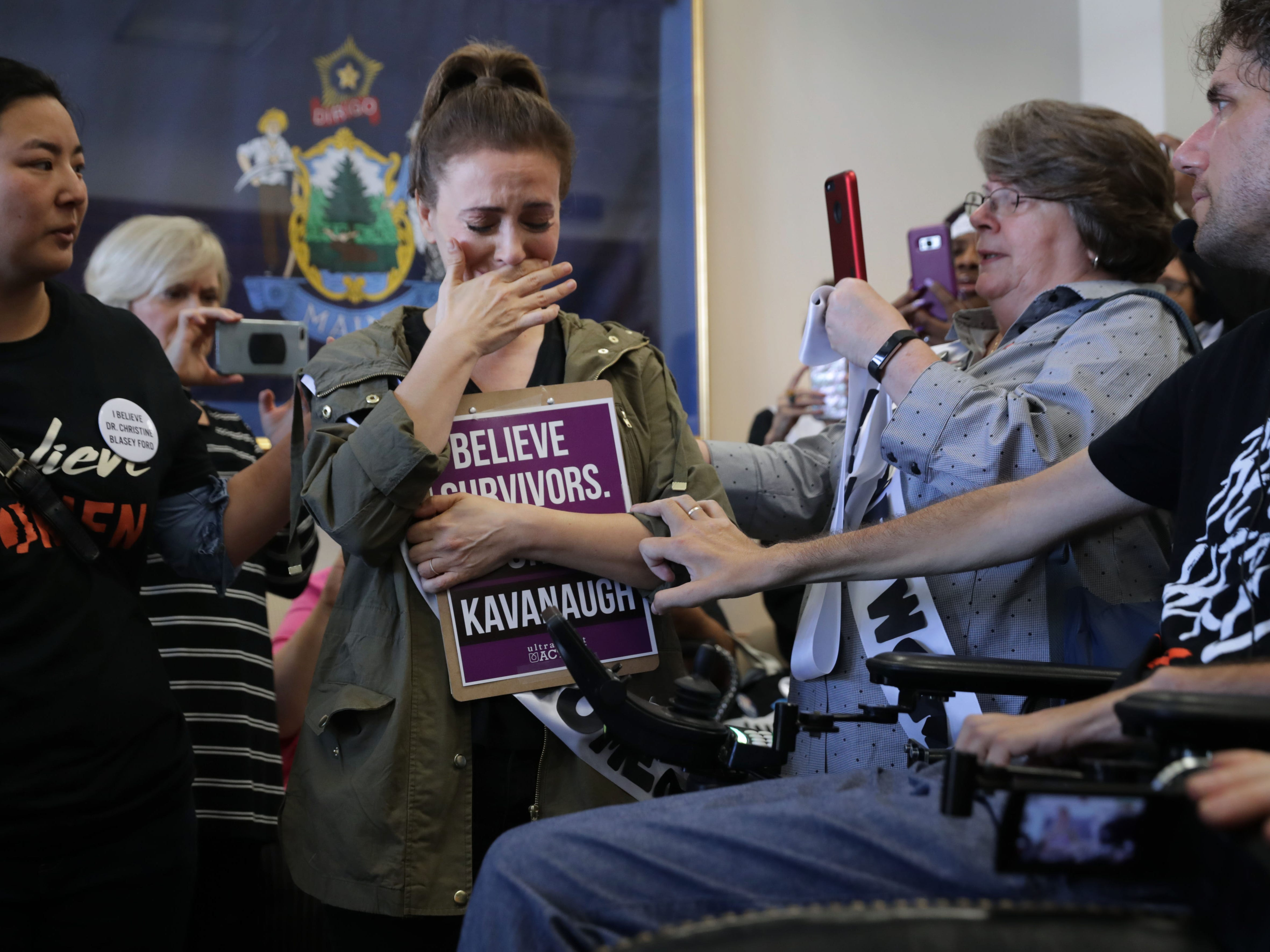 WASHINGTON, DC - SEPTEMBER 26: Actress Alyssa Milano is comforted after telling her story of being sexually assaulted while she and dozens of other protesters demonstrate against the appointment of Supreme Court nominee Judge Brett Kavanaugh  in the office of Sen. Susan Collins (R-ME) in the Dirksen Senate Office Building on Capitol Hill September 26, 2018 in Washington, DC. More than a dozen protesters, many of them survivors of sexual assault, were arrested after visiting the offices of three women senators to demonstrate against the appointment of Kavanuagh, who has been accused by at least two women of sexual assault. (Photo by Chip Somodevilla/Getty Images) ORG XMIT: 775233312 ORIG FILE ID: 1044928400