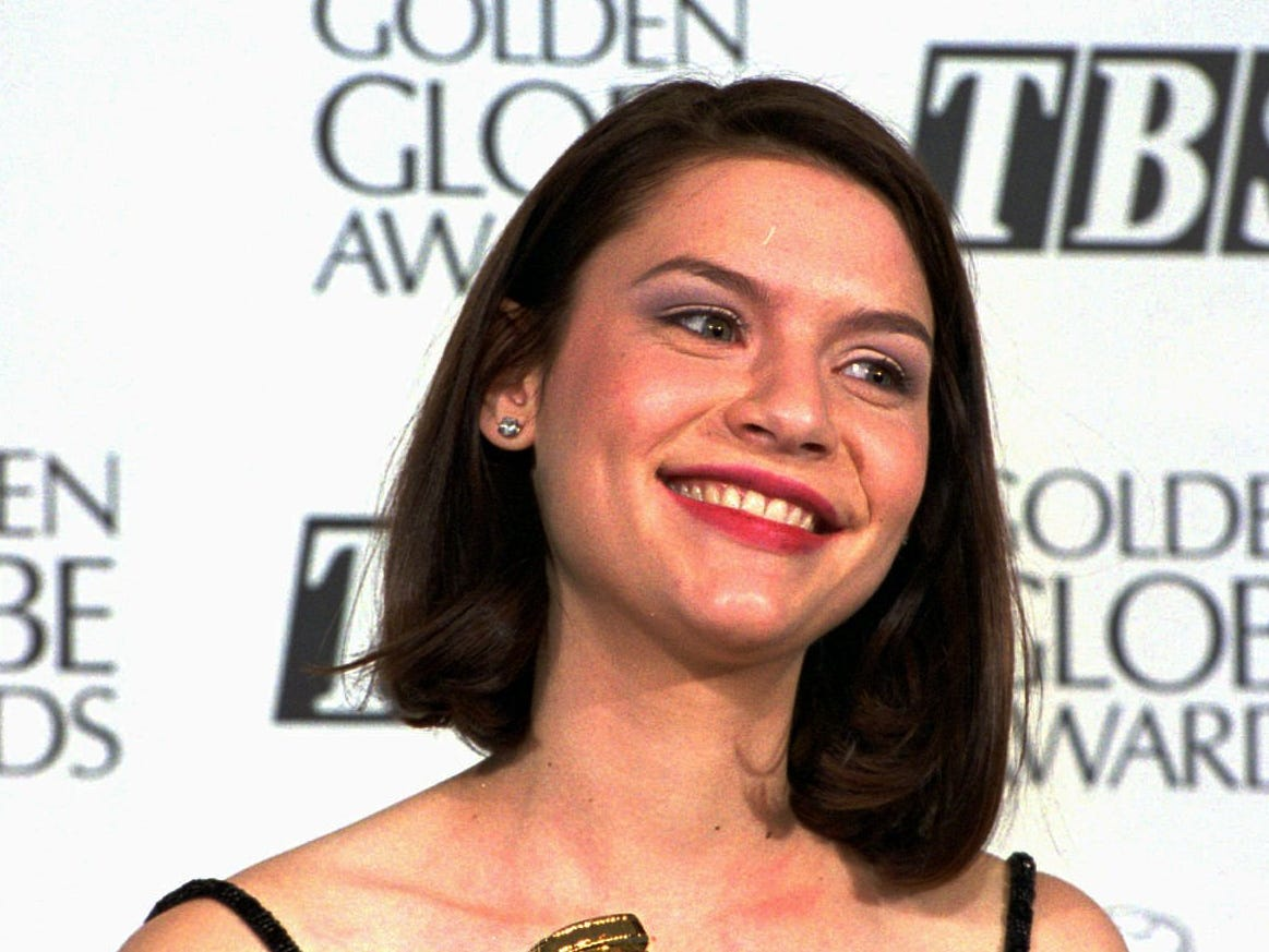 "Actress Clare Danes grasps her award for best performance by an actress in a television series-drama at the 52nd annual Golden Globe Awards in Beverly Hills, Calif., Saturday, Jan. 21, 1995. Danes appears in the series, ""My So-Called Life."" (AP Photo/Reed Saxon) ORG XMIT: LA119"