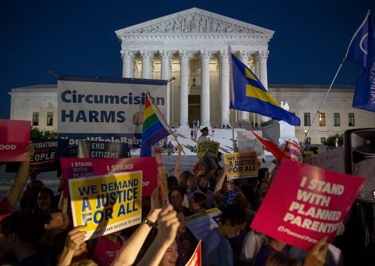 Protesters demonstrate in front of the Supreme Court on July 9 after President Donald Trump nominated Brett Kavanaugh.