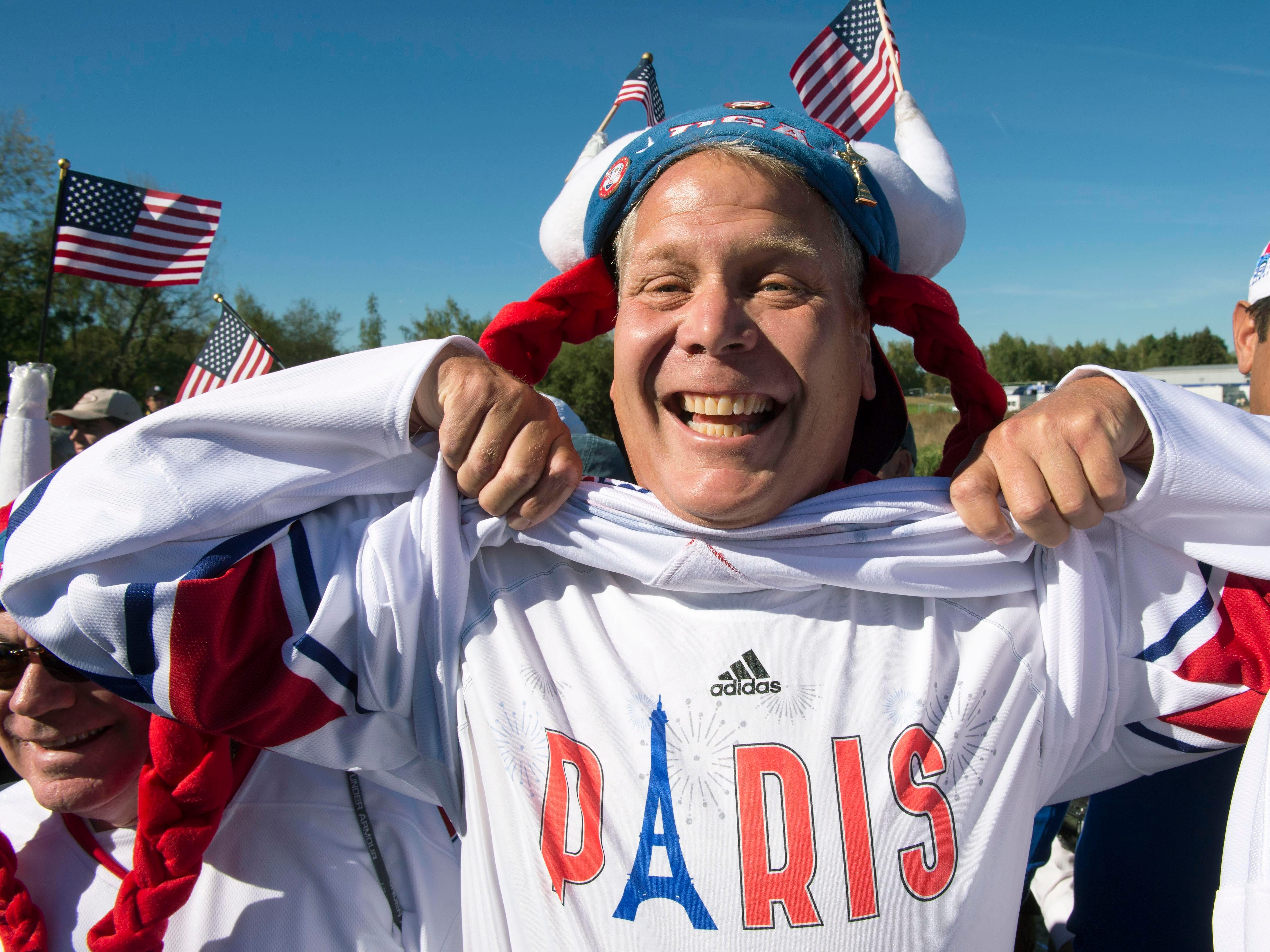 A Team USA fans shows his shirt during a Ryder Cup practice round.