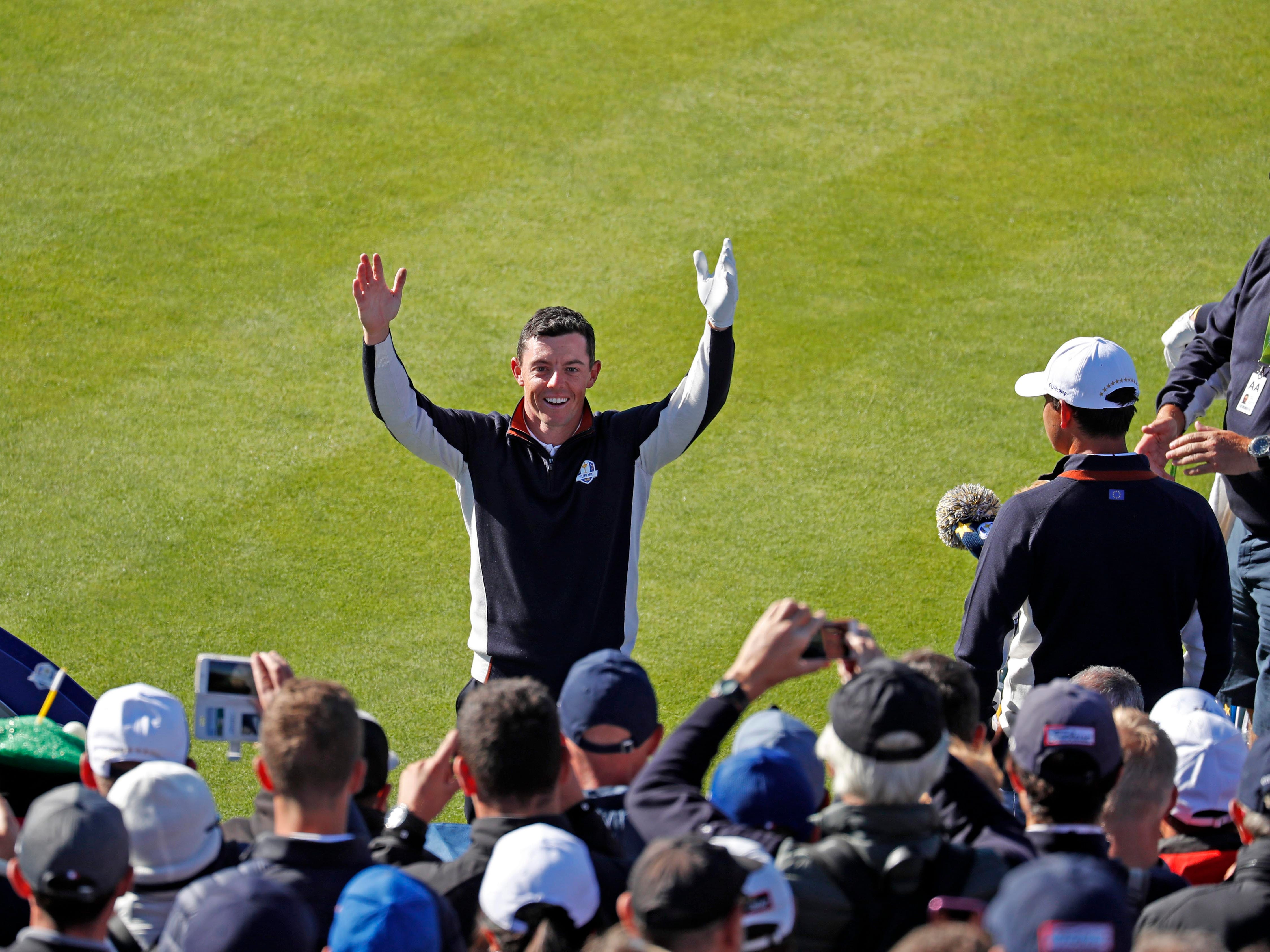 European golfer Rory McIlroy leads the European fans in a cheer on the first tee during a Ryder Cup practice round.