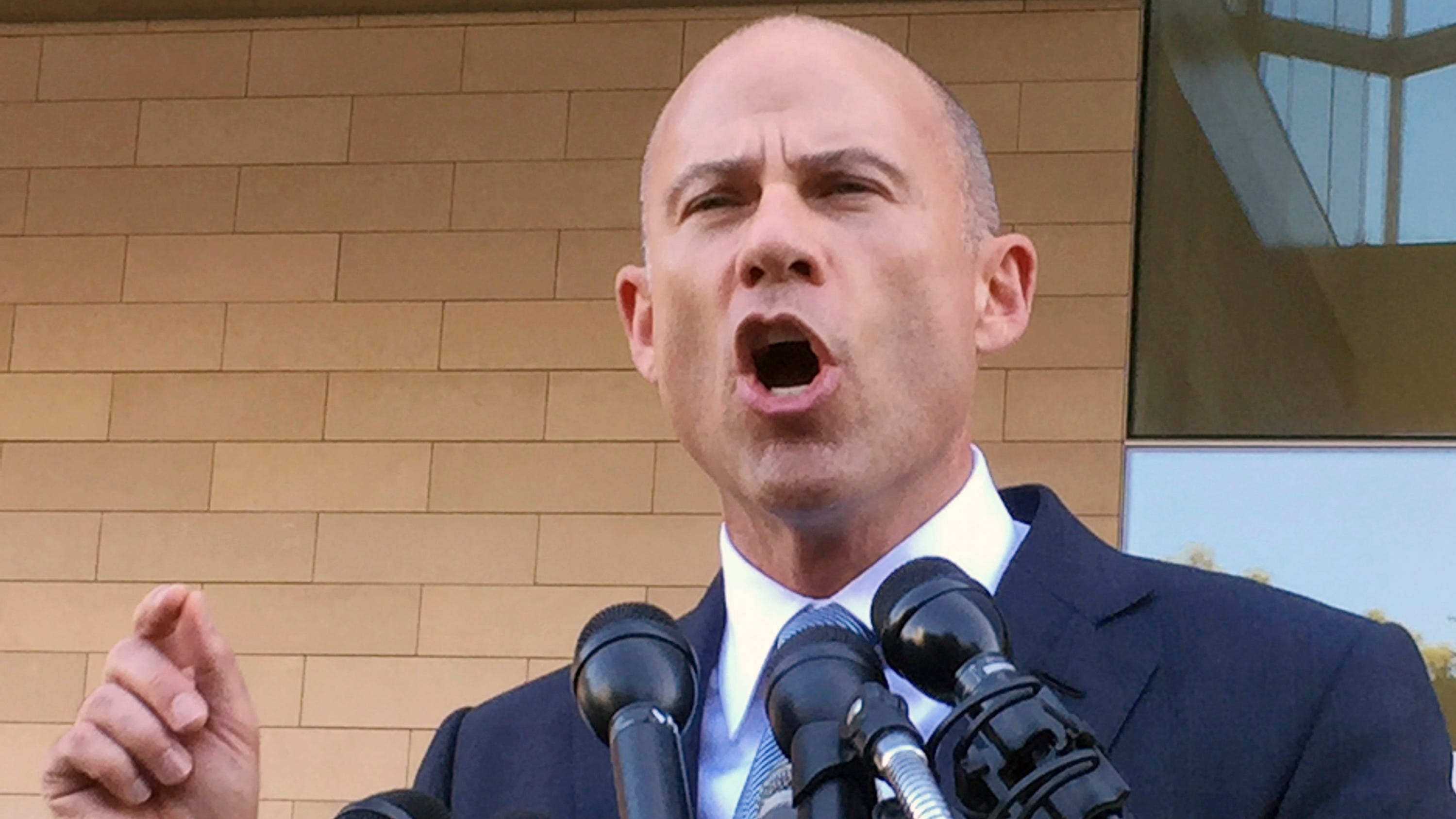 Michael Avenatti, attorney for porn actress Stormy Daniels, talks to reporters after a federal court hearing in Los Angeles, Sept. 24, 2018.