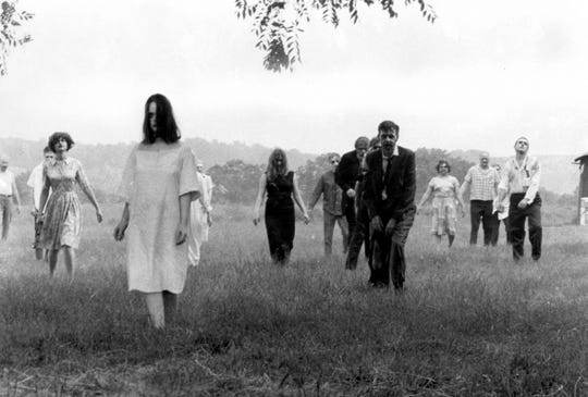 "Zombies shamble across rural Pennsylvania in the classic ""Night of the Living Dead."""