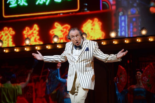 "Eric Idle performs on closing night of ""Monty Python Live (Mostly)""' at The O2 Arena on July 20, 2014 in London."