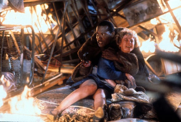 """Tony Todd (with Virginia Madsen) stars as the hook-handed title villain of """"Candyman."""""""