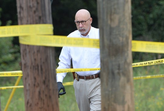 Anderson County deputy coroner Don McCown at a shooting death behind 327 East Shockley Ferry Road in Anderson. Anderson County Deputy Coroner Charlie Boseman said Lawrence Blackwell Jr., 23, and another man were apparently trying to break into a back door at Prowlers Lounge when a person who was watching the building shot Blackwell in the head.