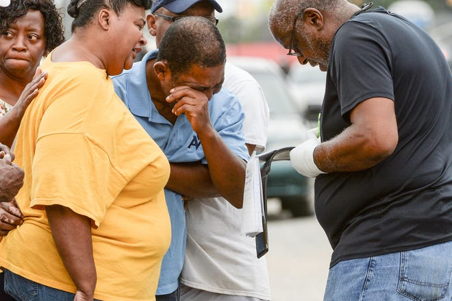 Chief Deputy Coroner Charlie Boseman, right, informs Lawrence Blackwell Sr., father of Lawrence Blackwell Jr., about his death in Anderson on Thursday, Sept. 27, 2018. Boseman said Lawrence Blackwell Jr., 23, and another man were apparently trying to break into a back door at Prowlers Lounge when a person who was watching the building shot Blackwell in the head.