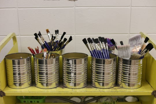 Paintbrushes in Carolyn Scalfano's classroom at Pineville Elementary.
