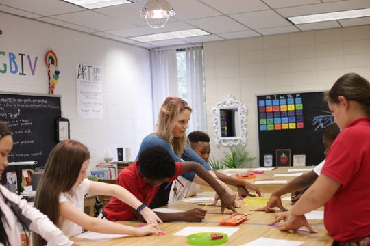 Carolyn Scalfano guides sixth-graders at Pineville Elementary as they learn to draw a one point perspective during art class. The district added art to 10 schools in Rapides Parish this year, including Pineville Elementary.