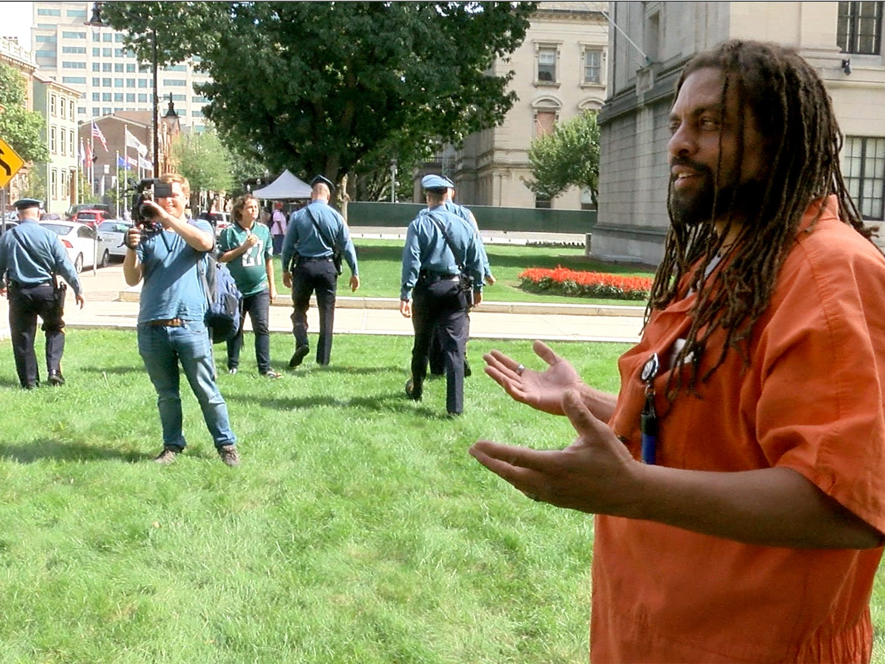 State Police walk away after asking Ed Forchion, known best as NJ Weedman, to leave the front of the Statehouse Annex on West State Street in Trenton Thursday, September 27, 2018.  He billed this as his boldest stunt - selling marijuana outside the Statehouse while daring police to arrest him.
