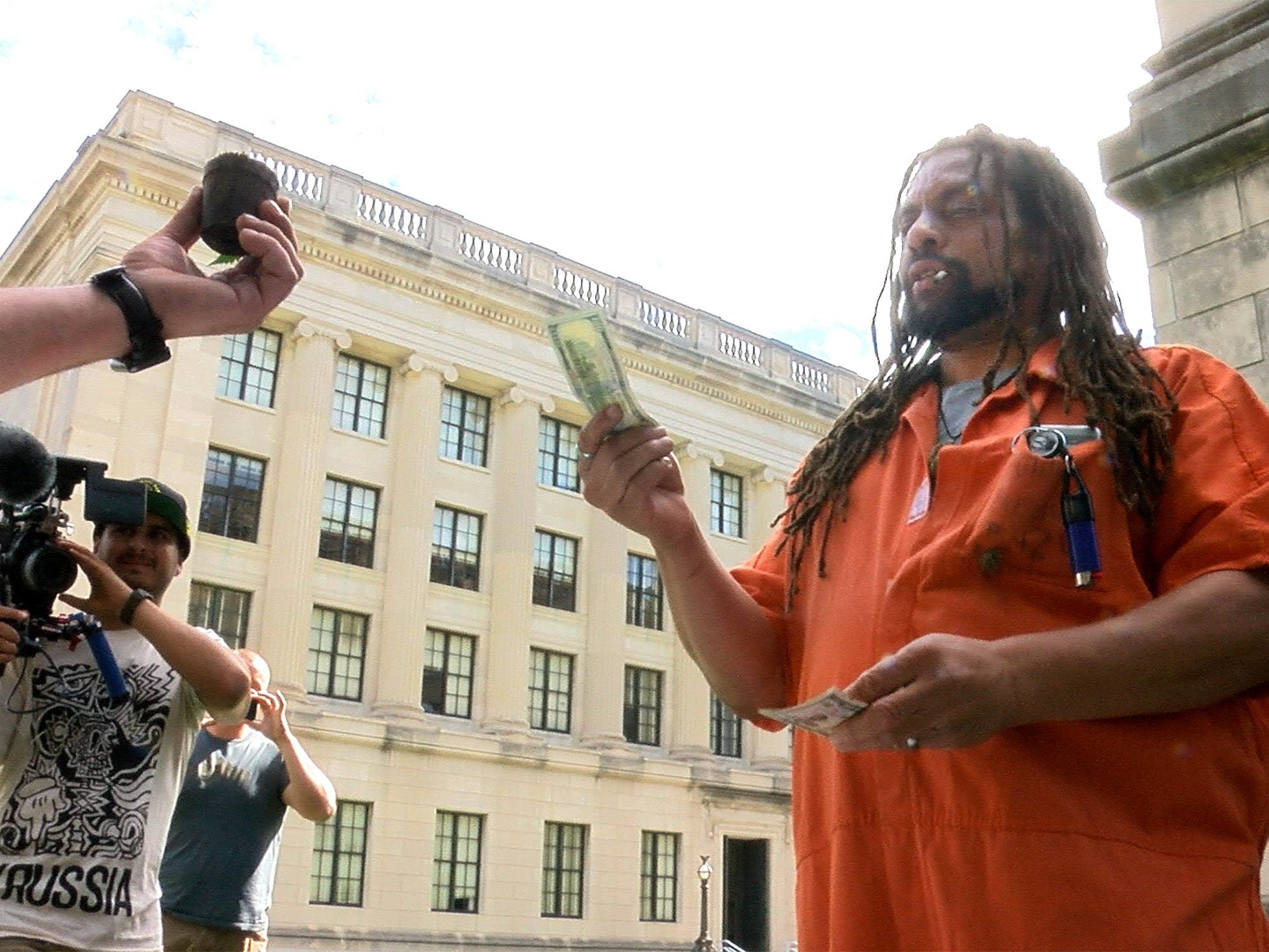 Ed Forchion, known best as NJ Weedman, sells a marijuana plant outside the Statehouse Annex on West State Street in Trenton Thursday, September 27, 2018.  He billed this as his boldest stunt - selling marijuana outside the Statehouse while daring police to arrest him.