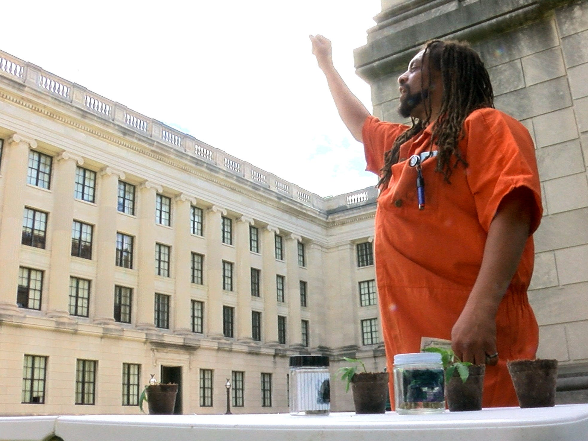 Ed Forchion, known best as NJ Weedman, sets up a table to sell marijuana outside the Statehouse Annex on West State Street in Trenton Thursday, September 27, 2018.  He billed this as his boldest stunt.