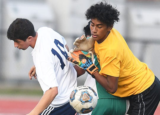 Long Branch keeper Rodolfo Giron makes a save as Howell Boys Soccer defeats Long Branch 2-1 on 9/26/2018
