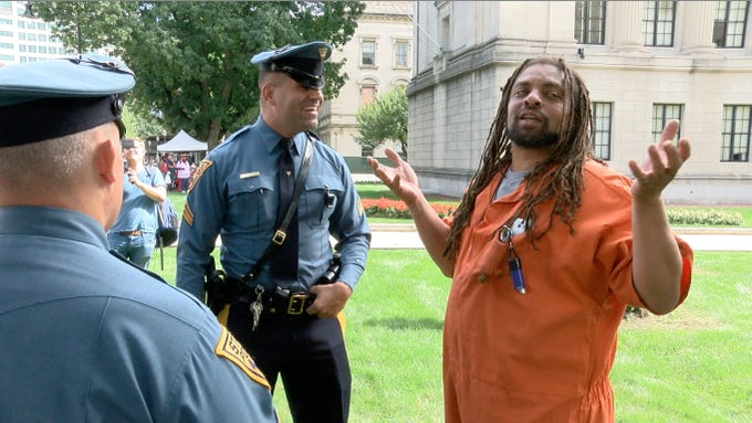 State Police talk with Ed Forchion, known best as NJ Weedman, outside the Statehouse Annex on West State Street in Trenton Thursday, September 27, 2018.  He billed this as his boldest stunt - selling marijuana outside the Statehouse while daring police to arrest him.