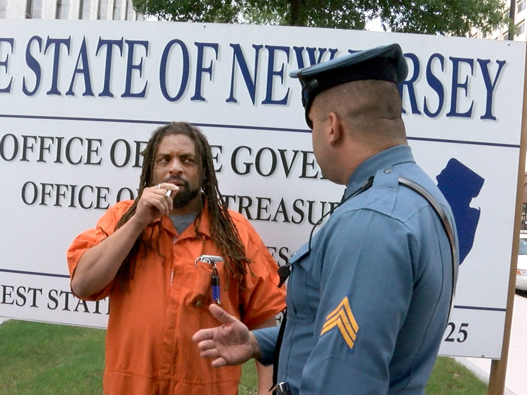A State Trooper asks Ed Forchion, known best as NJ Weedman, to leave the front of the Governor's office on West State Street in Trenton Thursday, September 27, 2018.  He billed this as his boldest stunt - selling marijuana outside the Statehouse while daring police to arrest him.