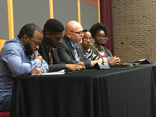 Former Jackson resident Ron Pierce (center, at microphone) speaks at Rutgers about restoring the vote to those in prison, on probation and on parole.
