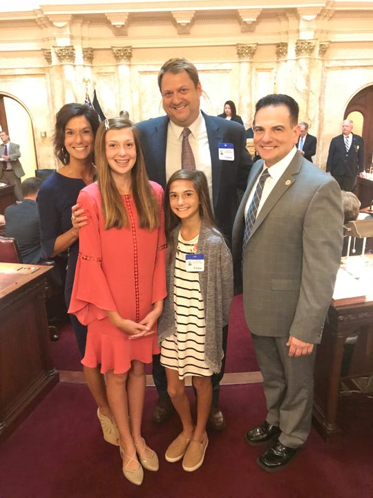 Incoming Ocean County Prosecutor Bradley Billhimer, with his wife Alyn and daughters Mackenzie, 14, and Riley, 11, pose with Sen. Nicholas Scutari, D-Union, chair of the Senate Judiciary Committee in the State House Thursday.