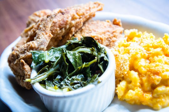 Bee-dusted fried chicken with collard greens and mac and cheese offered at Tupelo Honey.