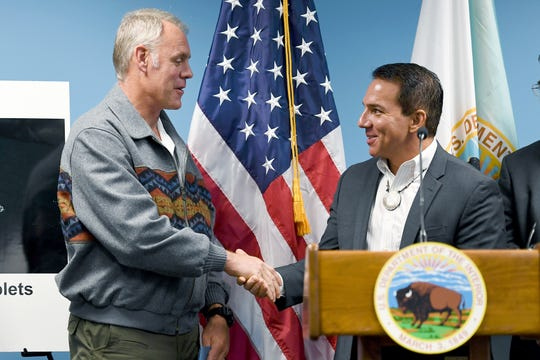 U.S. Secretary of the Interior Ryan Zinke shakes hands with Richard Sneed, principal chief of the Eastern Band of Cherokee Indians, during a press conference announcing the success of an opioid reduction task force. The Eastern Band has seen routine operations interrupted during the partial shutdown of the federal government.