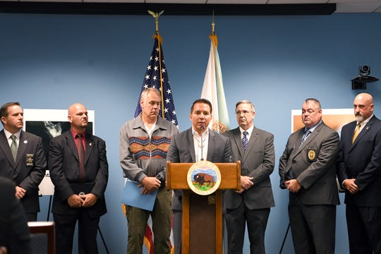 Richard Sneed, the Principal Chief of the Eastern Band of Cherokee Indians, speaks during a press conference announcing the success of a federal opioid reduction task force initiative that led to 76 drug-related arrests in and around the Qualla Boundary at the Veach Baley Federal Building on Sept. 27, 2018.