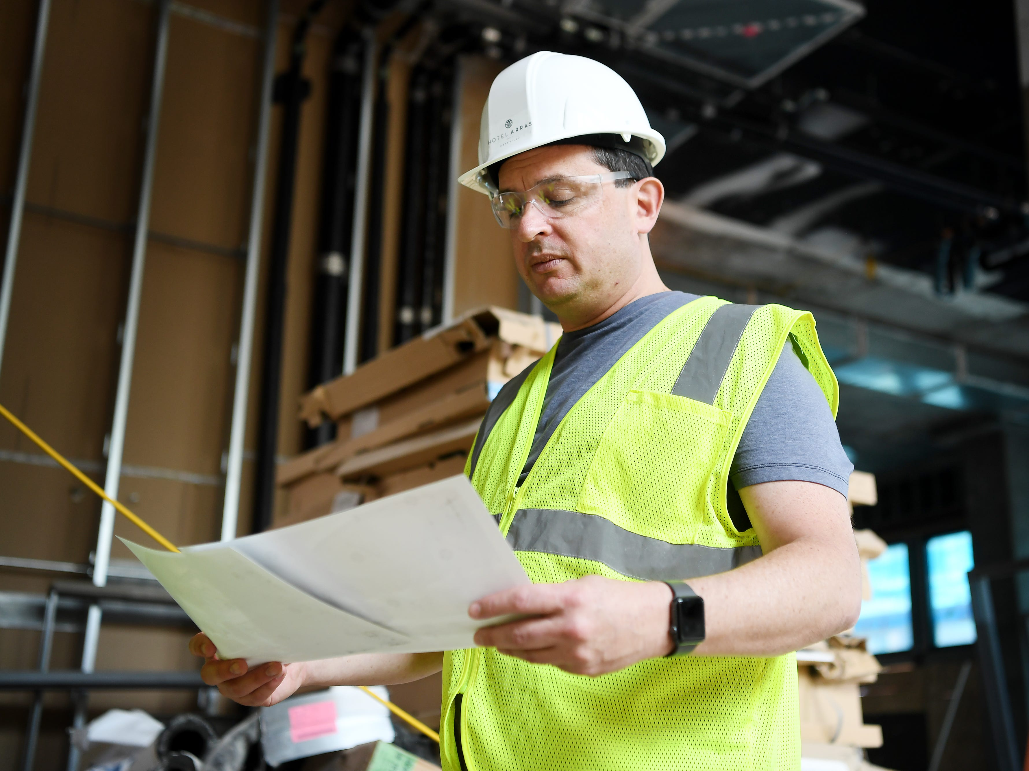 Peter Pollay, owner of Posana, looks at renderings of his future restaurant, Bargello, inside Hotel Arras Sept. 27, 2018.