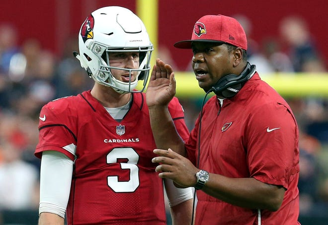 Cardinals quarterback Josh Rosen (3) talks with quarterbacks coach Byron Leftwich during the second half of an NFL football game against the Chicago Bears. Four games into his NFL career, Rosen is a starting quarterback and his job is a tough one. He will lead the winless Cardinals into Sunday's game against Seattle.