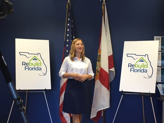 Erin Gillespie, deputy chief of staff for the Florida Department of Economic Opportunity, speaks with guests at the opening of a Rebuild Florida office, located in the CareerSource Brevard building  in Rockledge.