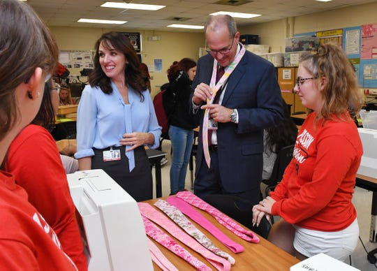 Brevard County Schools Superintendent Mark Mullins receives  originally made pink ties from Palm Bay High students for Breast Cancer Awareness Month in October.