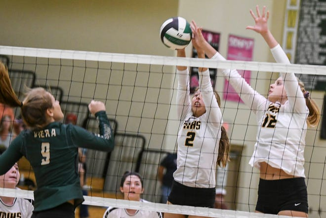 Taylor Jensen of Viera (9) has her shot blocked by Macie Sinclair (2) and Bobbie Jo Schwantz of Merritt Island during Wednesday's match.