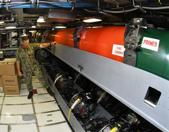 Cmdr. Jesse Kimbauer showing where the torpedoes are stored. A tour of the USS Indiana (SSN 789), the newest Virginia-class attack submarine which is the most modern and sophisticated in the world, and will be commissioned at the Navy port at Cape Canaveral Air Force Station on Sept. 29.